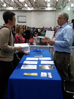 Greg Brussler, NASS State Statistician for Minnesota, staffing a booth at the International Cheese Technology Exposition in Madison, Wisconsin, last April.